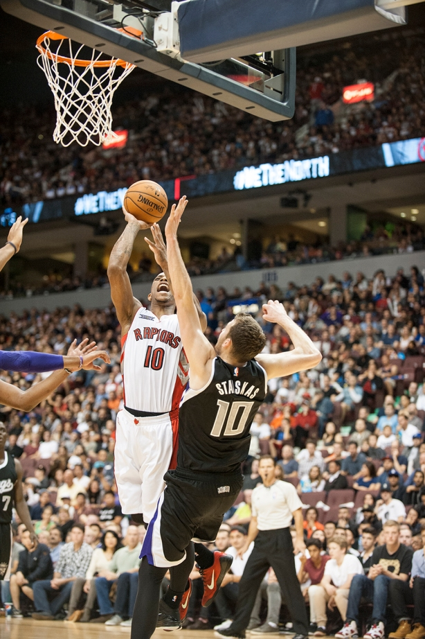 DeMar DeRozan drives to the net as Nik Stauskas attempts to defend him.