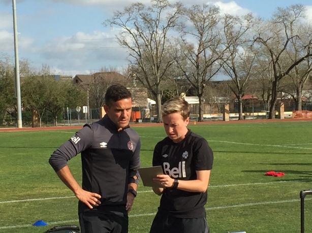 Canada Coach John Herdman taking in some information from Bev Priestman.