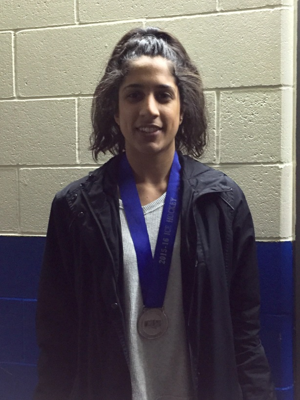 UBC Thunderbirds forward Haneet Parhar displaying the Silver Medal that UBC won at CIS Nationals.