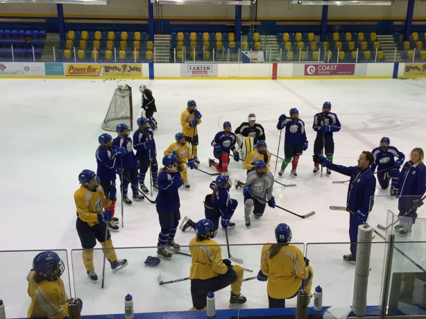 The UBC Thunderbirds listening to Coach Graham Thomas as he share practice drills on Thursday, December 8.