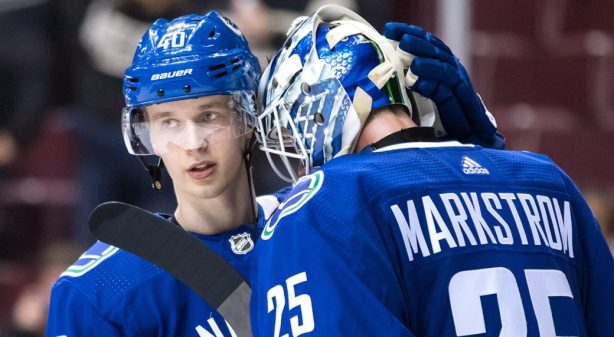 Canucks-Pettersson-congratulates-Markstrom-after-win-1040x572